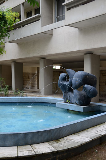 Mid-century modern residential building and sculpture, near Maison la Roche.